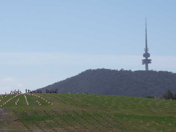 Wide Brown Land sculpture, with Black Mountain Tower