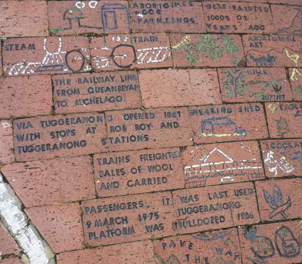 Brick mural - information about a Tuggeranong train service