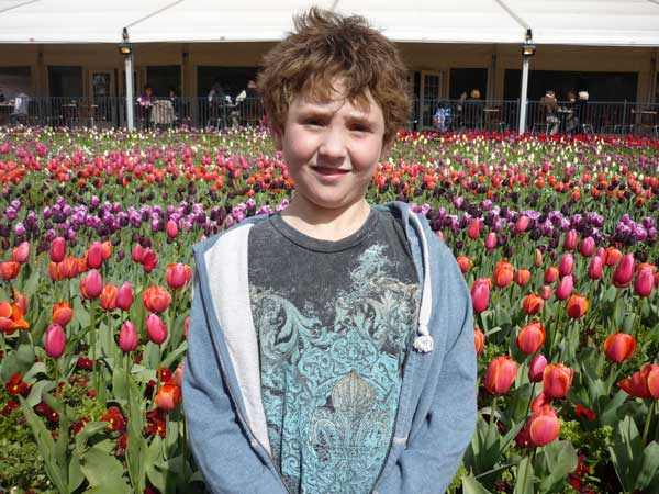 Daniel in front of an expanse of tulips at Floriade