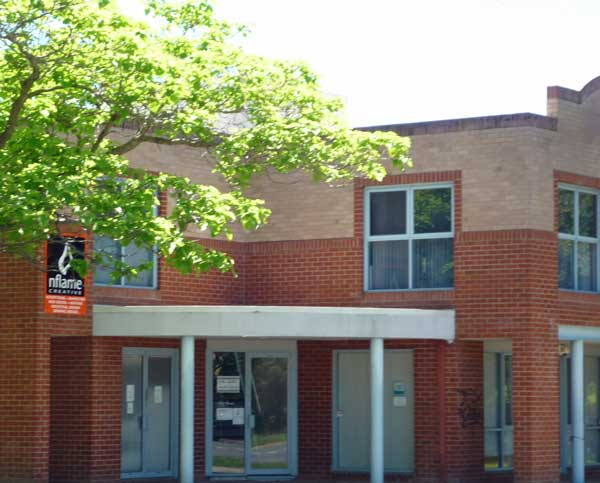 Brick corner building in Lyneham