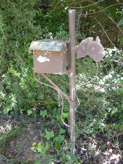 Patriotic letterbox: a brown metal letterbox featuring metal flourishes and a map of Australia