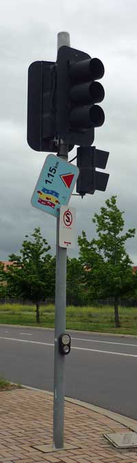 Traffic light with tipsy Canberra Community Walks sign