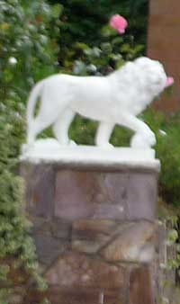 Gatepost with lion statue