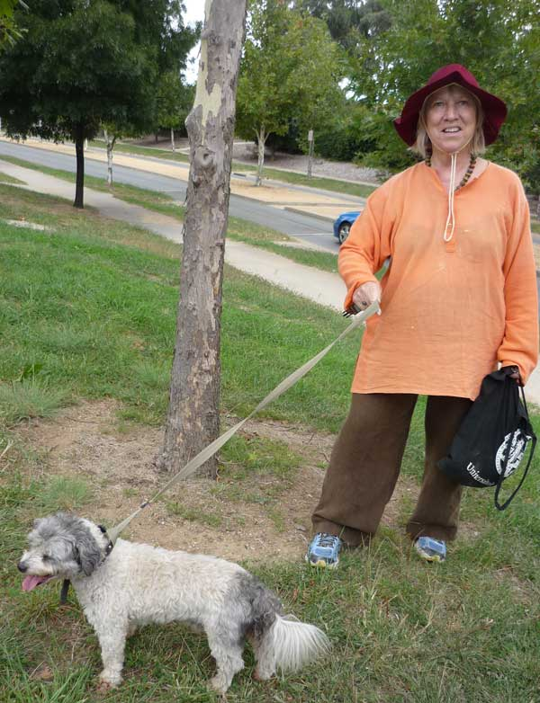 Jill holding Mitchy the Maltese-Shih Tzu cross on an improvised leash