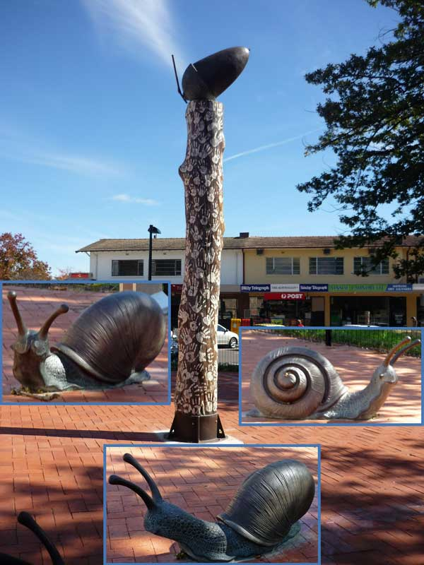 Playground at Ainslie shops with acorn on pillar surrounded by large snail sculptures