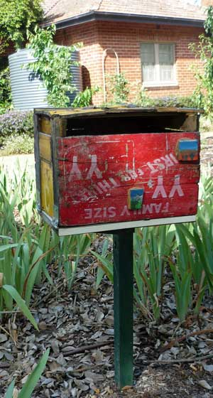 Letterbox made of old painted wooden boxes