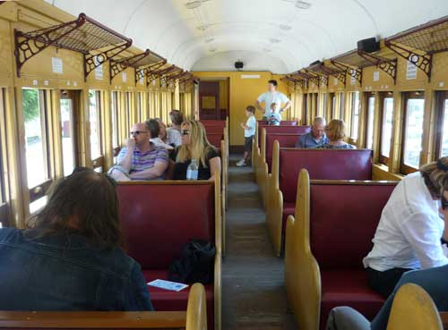 Carriage with wood and brass fittings and maroon seats
